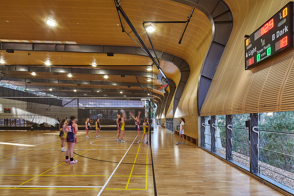 Abbotsleigh Multipurpose sports hall with students playing netball